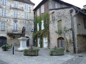 That is the house on the Place de la Bridolle, the one with ivy climbing the brick. The plaza is in the center of town, watched over then, and watched over now, by  the Virgin and Child.